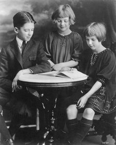 A 13-year-old Jimmy Stewart with his sisters