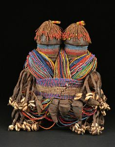 Africa | Fali doll from northern Cameroon | Wood, glass beads, coins, leather amulets, cotton threads amulets, leather strips, cowrie shells