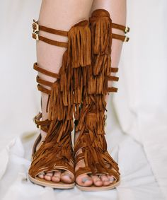 a554d639ec2ef7 This Three Bird Nest Brown Fringe Leather-Blend Gladiator Sandals by Three  Bird Nest is