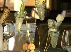 Small vases on metal stand for table setting. By Glass Studio