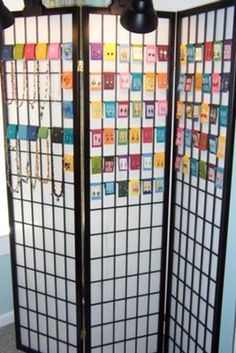 jewelry display out of a tri-fold screen.