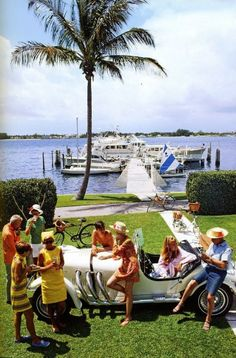 Palm Beach socialite Jim Kimberly (far left) and friends around his white sports car on the shores of Lake Worth, Florida, April (Photo by Slim Aarons/Getty Images) Jet Set, Lily Pulitzer, Vines, Serpieri, Palm Beach Florida, Positano, Amalfi, Lake Worth, Mode Vintage