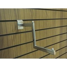 Slatwall stepped display arm: This stylish slatwall accessory is manufactured in metal and finished in a bright chrome. Perfect for clothing display on your slatwall panel or free standing slatwall display units.