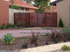 Merbau horizontal slat fence with double gate. - Night Owl Fencing