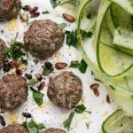 Mini Herby Lamb Meatballs are a quick and easy way to bake juicy and tasty meatballs for dinner! Serve with yogurt and cucumber salad for a refreshing supper or serve with dip at your next get together for a delicious appetizer. Mini Meatballs, Tasty Meatballs, Ground Lamb, Cucumber Salad, Yummy Appetizers, Tray Bakes, A Food, Food Processor Recipes, Dairy Free