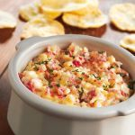 Crab Dip  8 oz Cream Cheese  1/2 Cup Sweet Onion (finely chopped)  1/4 Cup Parmesan Cheese  1/4 Cup Mayo  2 Garlic Cloves (minced)  2 tsp Sugar  6 oz Can Crab Meat  Assorted crackers for dipping  In a 1- to 2 quart slow cooker, combine the first six ingredients, stir in crab. Cover and cook on LOW for 2-3 hours, or until heated through.