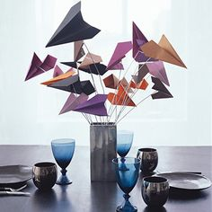paper airplane centerpiece. Good for cocktail table with glow light under it.