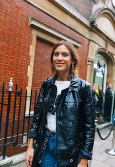 Alexa Chung spotted on the street at London Fashion Week. Photographed by Phil Oh.