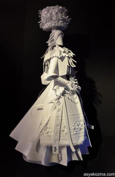 Wedding gear paper sculptures-The project is a series of paper sculptures of brides in various ethnic wedding gear. The artist lays emphasis in specific characteristics of wedding dresses in different countries. Each sculpture expresses the variety and richness of wedding gear and how embodies the most specific characteristics of each national costume.