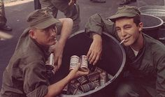 A couple of sailors with a bucket of beers.