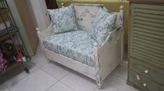 An old bed re purposed into a love seat and hand painted giving a vintage look!