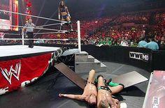 AJ puts CM Punk and Daniel Bryan through a table on Monday Night Raw: July 2, 2012