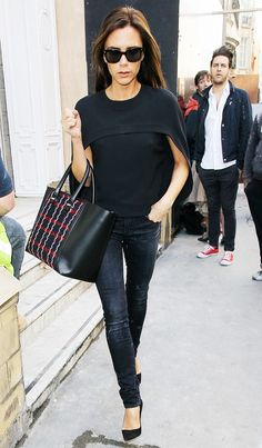 Victoria Beckham's Guide to Wearing All-Black Without Looking Boring via @WhoWhatWear