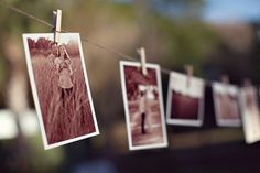 print engagement photos in sepia and hang on twine across wall in reception hall