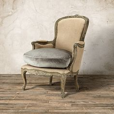 Charlotte side chair from Arhaus. This color wood with Arabella midnight cushion.