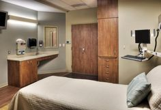 This patient room at Community Hospital in McCook, Neb., designed by HDR, features an observation window with integral shades to allow caregivers to check on patients without disrupting them and provide privacy, with additional caregiving elements including a handwashing sink adjacent to the door, a nurse server near the bedside for medications and supplies, and a bedside charting workstation. Credit: © 2011 Tom Kessler.