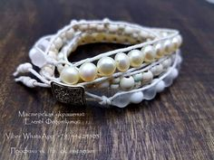 Stylish bracelet in the style of Chan Luu in three girths. It is made of natural stones. The first row - natural pearls, the second row - matte opalite and white quartz, the third row - white turquenite. The base is a waxed cord. Clasp - metal button.
