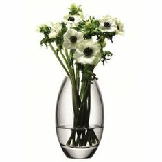 Elegance with Glamour! Enhance the aesthetic appeal of your interiors by placing fresh or artificial #flowers in this #vase.    #DiwaliDecor and #FabFurnish