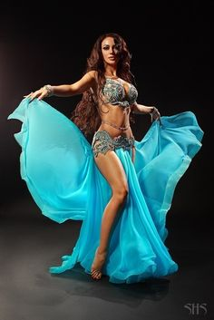 Gorgeous turquoise belly dance costume, don't know who the belly dancer is, but she is very beautiful too!