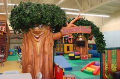 Themed Indoor Playground Themed tree entrance with a toddler play area in the back, # operations Toddler Play Area, Infant Play, Colegio Ideas, Kids Play Equipment, Indoor Playroom, Daycare Design, Kids Daycare, Daycare Ideas, Parc A Theme