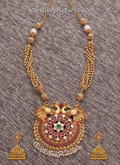 Latest Indian Gold antique jewellery haram design with dual peacock pendant with uncut ruby and diamonds round pendant. Indian Antique Jewellery haaram.