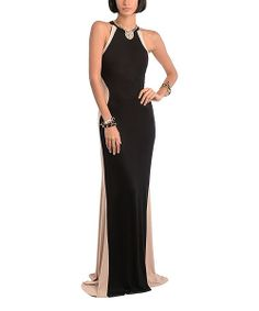 Put on the glam in a red carpet-worthy dress sure to turn heads. Featuring an elegant floor-sweeping silhouette and statement paneling, this gown boasts a romantic finish, while stretch-blend fabric ensures a snug yet pliable fit when dancing the night away!