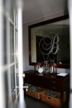 I love the big monogram on the entry mirror.