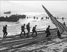 First Beach landing on Red Beach, DaNang area of Vietnam. Probably March 1965 3/9 Marines.