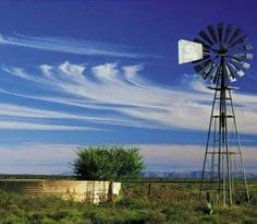 Windmill / Wind Turbine photo of the day. Lonely windmill in the Karoo pumping up precious water from underground in the Karoo National Park, South Africa copyright © South African tourism Farm Windmill, South Africa Tours, Old Windmills, What Image, Country Scenes, Water Tower, Old Farm, Le Moulin, New Art