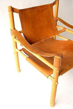 60s leather and wood chair from Salvage One in Chicago.  Like a Mai Thai-version of the Corbusier Armchair.