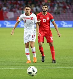 Cengiz Under of Turkey in action against Ferjani Sassi of Tunisia during the friendly football match between Tunisia and Turkey at Stade de Geneve in Geneva, Switzerland on June Get premium, high resolution news photos at Getty Images Geneva Switzerland, Football Match, June, Soccer, Action, Running, Sports, Image, Futbol