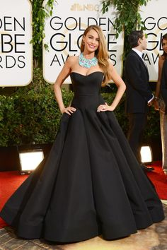 The dress in black is gorgeous! And the necklace completes it! sofia-vergara-vogue-13jan14-pa_b_592x888