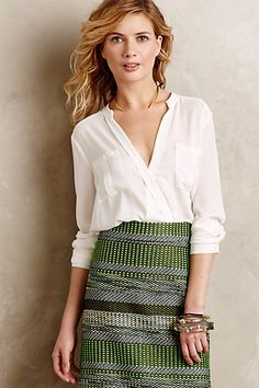 This top is so timeless -- I can imagine Marilyn Monroe or Grace Kelly wearing this look.  Slightly boyish with the pockets, but very light and feminine with the fit.  Eva Wrap Blouse #anthropologie
