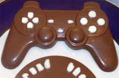 Chocolate Dual-Shock Controller Comes with Grand Theft Chocolate Game Disc.http://technabob.com/blog/2011/04/12/chocolate-dual-shock-controller/