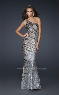 "This stretch sequined La Femme dress is perfect for the ""wow"" factor. With an intricate open back and a one shoulder strap with a side zipper. This La Femme prom dress 17303 is part of the 2012 prom collection of La Femme Prom dresses.     http://www.netfashionavenue.com/la-femme-prom-dress-17303---prom-dresses-2012-by-la-femme.aspx"