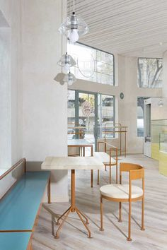 The Madrid-based architecture firm Lucas y Hernández-Gil has reshaped a compact corner in the city's residential Retiro and Salamanca neighbourhoods to form a light-filled café and bakery. The highlight is the hand-painted yellow and white square tiles...