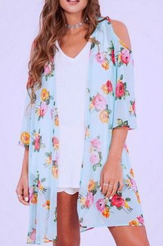 Half sleeve mint floral printed cold-shoulder chiffon kimono. (100% Polyester) - Our model is pictured wearing the size small kimono.