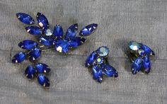 Vintage Blue Floral Rhinestone Brooch and Clip-on Earring Set. $25.00, via Etsy.  You could always use a set like this with the broach in your hair or on your belt.