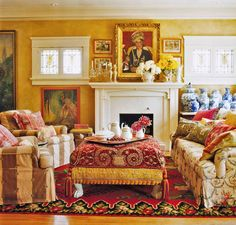 I love the idea of a beautiful scarf with big tassels covering the ottoman. What a great way to change the look of a room instantly.