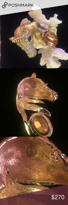 """EXTREMELY RARE signed vintage CINER UNICORN brooch Gorgeous ...signed Ciner... large... rare... golden crystal unicorn pin/brooch.-composed of heavy gage gold tone metal framework, beautifully etched with detail and studded with brilliant crystal rhinestones. His golden mane encircles a large oval, faceted cut, foil back honey colored crystal. This beautiful brooch has a heart stopping face set off by two beautiful sapphire blue crystal eyes. He measures 3"""" long by 2"""" wide, is in lnew…"""