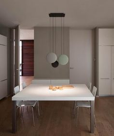 COSMOS | Designed by Lievore Altherr Molina I COSMOS, inspired by planetary orbs, is a stunning eclectic pendant due to the perfect balance of design and light source.