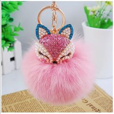 Genuine Fox Fur Pom Pom Keychain/Bag Charm PLEASE DONT PURCHASE THIS LISTING Let me know and I'll make you one. Blue earrings is the one being sold Accessories Key & Card Holders