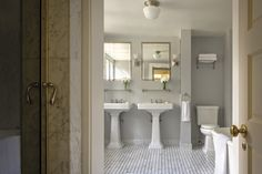 classic bath.  gray wall color, double pedestal sinks, and marble flooring   ferguson shamamian architects