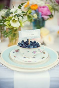 Maine blueberry teacup place settings for a vintage or barn wedding.    www.shadylanefarmme.com