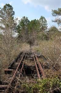Abandoned Alabama Midland Railroad bridge over the Pea River in Elba, Alabama.