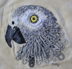 Charlotte Bailey covered paperclips with detached buttonhole stitch to create neck feathers for this already epic parrot embroidery. Embroidered Bird, Bird Embroidery, Cross Stitch Embroidery, Embroidery Designs, African Grey Parrot, Lesage, Trombone, Embroidery Techniques, Paper Clip