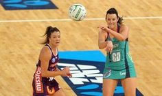 Melbourne Vixen Bianca Chatfield passes the ball past Verity Simmons of the Queensland Firebirds in the semi-finals of the ANZ Netball Championships at Hisense Arena in Melbourne.