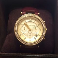 Michael Kors watch with leather band. My late valentines present from my guy. Love it.