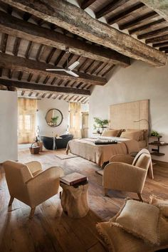 The Suite Sant' Andrea boasts a sumptuous king-size bed, surrounded by antique, oak wood floors and wood-beamed ceilings.