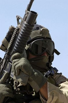 A Navy SEAL, armed with a M4A1 Carbine fitted with a M203 grenade launcher, pictured during Desert Rescue X on June 18, 2002. Desert Rescue X is a combat search and rescue exercise.
